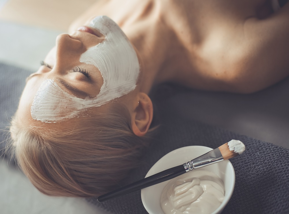women getting a facial laying down