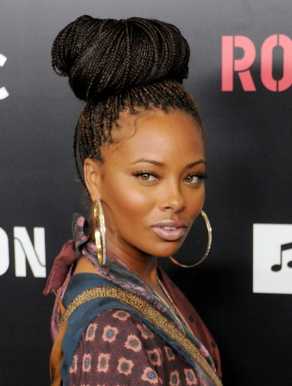 women with braided bun hairstyle looking into camera on red carpet