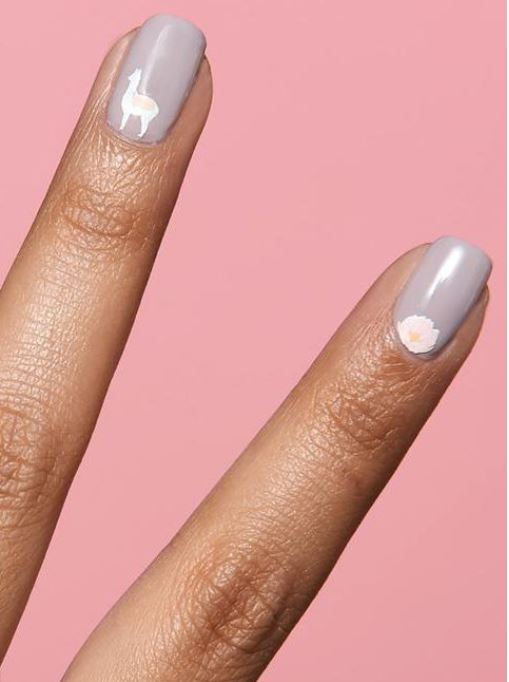 white nail art stickers on lavender nails