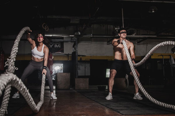 man and woman holding ropes