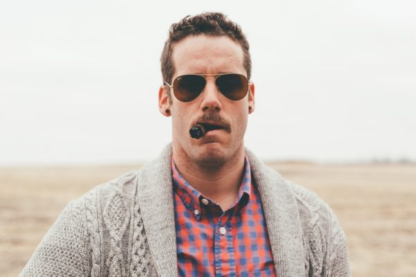 Example of a man with a shaped mustache.