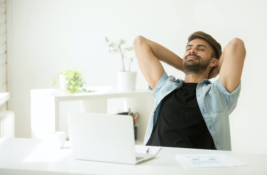 Man de-stressing at home by trying a breathing exercise.