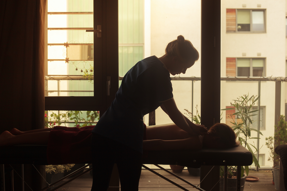 A mobile massage therapist at a client's home.