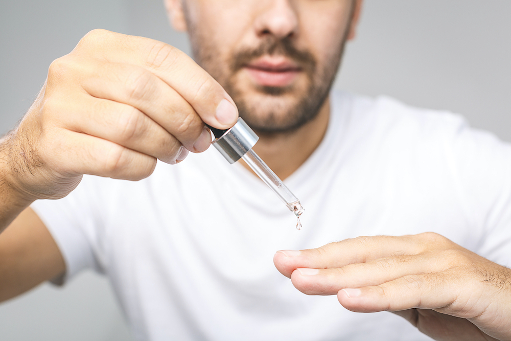 Man using cuticle oil as an aftercare step.