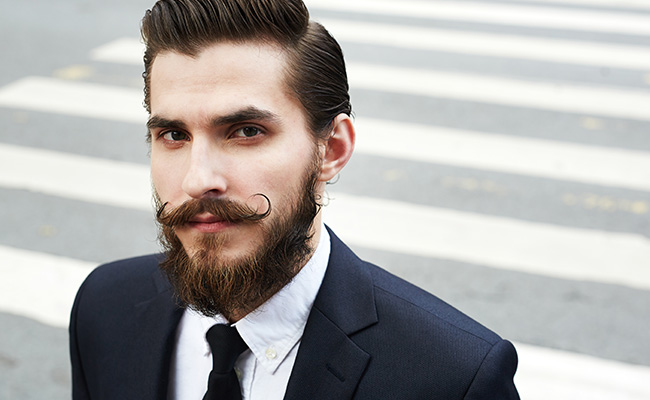 A man with an intricate beard style.