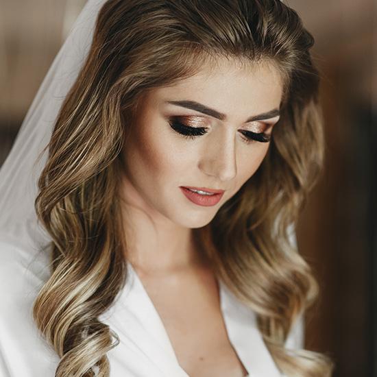 A bride with eyebrow-forward wedding makeup.