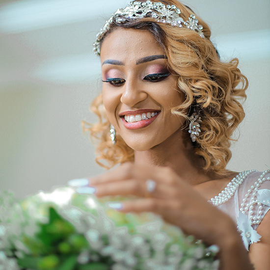 A beautiful bride with pink and coral wedding makeup.