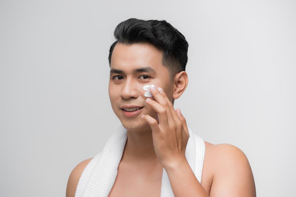 Man applying sunscreen.