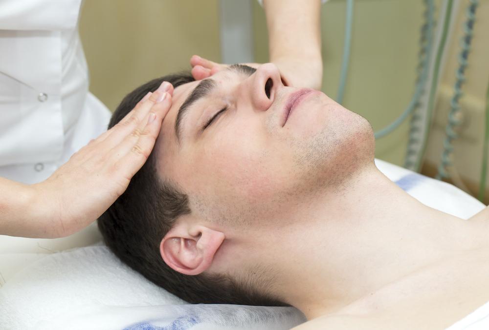 A male getting an esthetician massage.