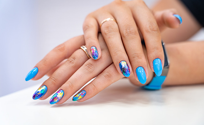 Nails that aren't patterned, but colorful and bright.