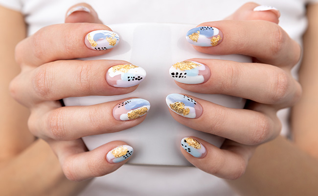 Colorful, marble, patterned nails.
