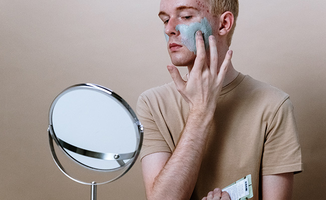 Example of using a face mask as part of a men's skincare routine.