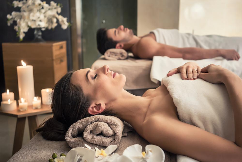Couple enjoying spa treatment.