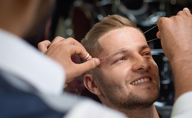 Example of eyebrow threading process.