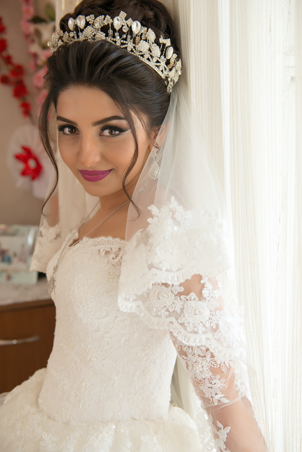 Beautiful bride with updo and wedding hairpiece.